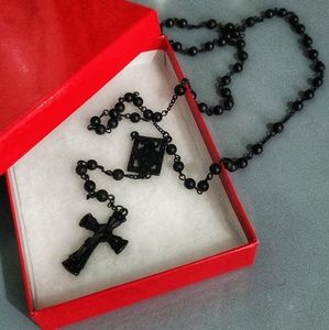 Black rosary necklace.